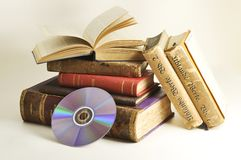 Antique books with CD. Some old books with a CD on a white background Royalty Free Stock Photography