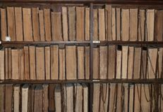 Antique books chained to the bookshelves