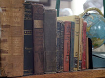 Antique books with globe Stock Images