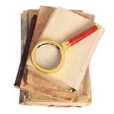 Antique books, gold magnifying. Stack of books and magnifying glass isolated on white background Royalty Free Stock Image