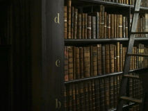 Antique Books and Ladder in Library Stock Photography