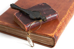 Antique books and lorgnette Royalty Free Stock Photography