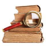 Antique books and magnifying glass. Stack of books and magnifying glass isolated on white background stock photography