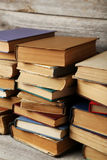 Antique books. Old antique books on grey wooden table stock image