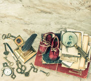 Antique books and photos, keys and writing accessories royalty free stock photos