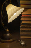 Books Still Unread. Antique books, reading lamp and glasses Royalty Free Stock Photo