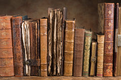 Antique books in a row. Row of ancient books some of them over 300 years old stock images