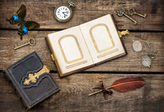 Antique books, writing accessories and butterfly Royalty Free Stock Photo