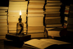 Antique books on a writting desk. Royalty Free Stock Photography