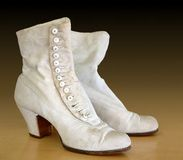 Antique Boots. 19th Century style linen boots with lots of tiny buttons Stock Photos
