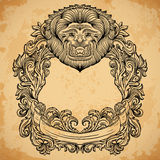 Antique border frame engraving with lion head and baroque cartouche ornament.  Stock Image