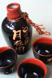 Antique bottle. Oriental style bottle and teacups stock image