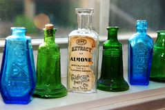Antique Bottles. Collection of vintage small bottles on a shelf Royalty Free Stock Images