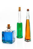 Antique bottles with colorful liquids Stock Photography
