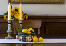 Antique bowl, candlesticks, lemons Stock Photography