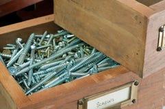Antique Box of Screws Stock Image