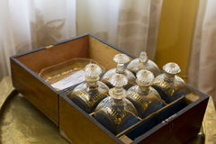 Antique brandy bottles in wooden box Royalty Free Stock Images
