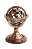 Antique brass armillary sphere on a wooden stand Stock Image