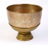 Antique brass mantra bowl isolated on white. Old antique brass mantra bowl for some religion ceremony, the image isolated on white Stock Photos