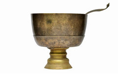 Antique brass bowl and ladle Royalty Free Stock Photo