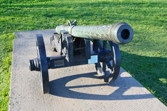 Antique brass cannon Stock Images