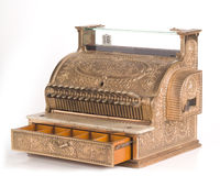 Antique Brass Cash Register. Antique Brass National Cash Register with the drawer open, sitting on a glossy white surface with white background royalty free stock photos