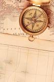 Antique brass compass. Over old Alaska map royalty free stock photos