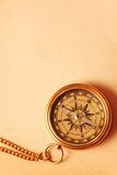 Antique brass compass. Over old map background royalty free stock photography