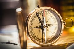 Brass antique compass on blurred background. Antique brass compass background object decorative equipment Stock Photography
