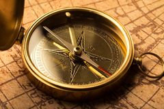 Brass antique compass, close-up view. Antique brass compass background object decorative equipment Royalty Free Stock Photos