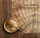 Brass antique compass close-up view. Antique brass compass background object decorative equipment stock photos