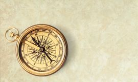 Brass antique compass on grey background. Antique brass compass background object decorative equipment Stock Image