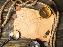 Brass antique compass on wooden background. Antique brass compass background object decorative equipment Stock Photo