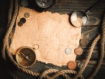 Brass antique compass on wooden background. Antique brass compass background object decorative equipment Royalty Free Stock Photos