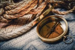 Brass antique compass on wooden background. Antique brass compass background object decorative equipment Stock Photography