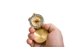Antique brass compass in a hand isolated on white Stock Photography
