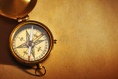 Antique brass compass over old background Stock Image