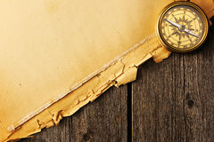 Antique brass compass over old background Stock Images