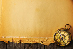 Antique brass compass over old background Stock Photography