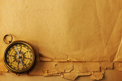 Antique brass compass over old background Royalty Free Stock Photo