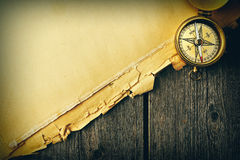 Antique brass compass over old background royalty free stock photos