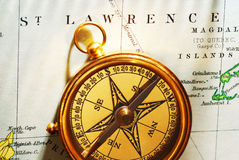 Antique brass compass over old Canadian map Stock Photography