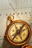 Antique brass compass over old Canadian map Royalty Free Stock Images