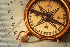 Antique brass compass over old Canadian map Stock Images
