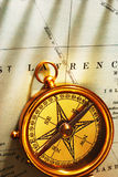 Antique brass compass over old Canadian map Royalty Free Stock Image