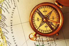 Antique brass compass over old Canadian map Stock Photo