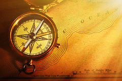 Antique brass compass over old USA map Royalty Free Stock Photography