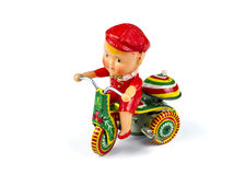 Antique brass doll: child and tricycle Stock Image