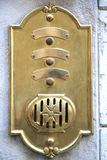Antique brass doorbell in Italy Royalty Free Stock Photography