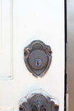Antique brass keyhole of the white entrance door Royalty Free Stock Images
